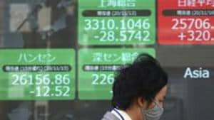Asian shares ticked up as US President Donald Trump signed into law a 2.3 trillion dollar pandemic aid and spending package he had until now refused to sign.(AP)