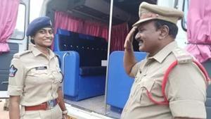 Circle inspector Y Shyam Sunder saluting his daughter, deputy superintendent of police Yendluru Jessy Prashanthi, at the Andhra Pradesh Police Duty Meet in Tirupati.(Sourced)