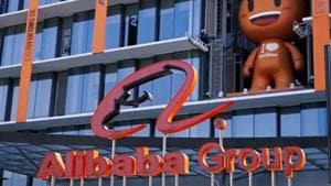 Alibaba, which sat on a cash hoard of almost $90 billion at the end of September, continues to wage a bruising battle with Meituan in food delivery, while fending off rivals like JD.com Inc. and Tencent Holdings Ltd. in businesses from groceries to retail.(REUTERS)