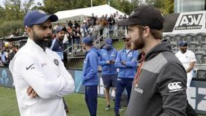 Indian captain Virat Kohli, left, talks with New Zealand captain Kane Williamson(AP)