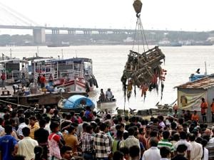 Corporation workers collecting the remnants of the goddess Durga idols after immersion to avoid pollution of river Ganga in Kolkata after the end of Durga puja celebrations