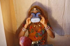 A woman goes through the process of eye scanning for Unique Identification (UID) database system at an enrolment centre at Merta district in Rajasthan February 21, 2013.
