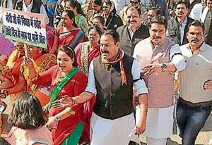 Gwalior district Congress president Darshan Singh (in black jacket) during protest march on Monday.