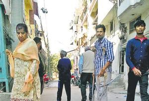 Residents passing by a manhole at Basant Nagar in Ludhiana on Monday.