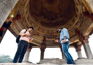 Paranormal investigators Amit Singh and Tathagata Marik near the Jamali Kamali monuments.