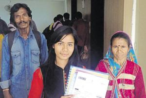 Asha Gond with her parents at the passport office in Bhopal.