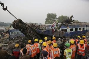 Rescuers search for survivors after 14 coaches of the Indore-Patna passenger train rolled off the track near Pukhrayan village Kanpur Dehat district, UP.