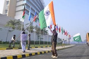 Workers putting up flags of various countries participating in the Heart of Asia ministerial conference, in Amritsar on Friday. The sixth Heart of Asia conference, which will discuss peace, cooperation and economic development in Afghanistan, takes place in the city on December 3 and 4.
