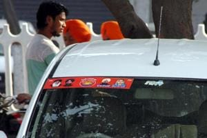 Political stickers pasted on vehicle in Ludhiana on Saturday.