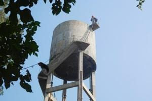 NRI climbs water tank to protest 'inaction' in Rs 3-cr cheating...