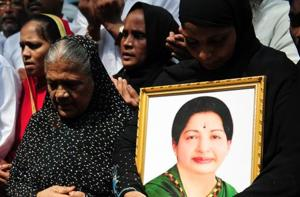 Indian Muslims hold a portrait of Tamil Nadu CM Jayalalitha Jayaram as they pray for her well being in front of a hospital.