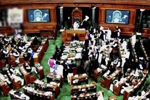 Opposition party MPs crowd in the well of the Lok Sabha protesting against demonetisation. The opposition started a debate on demonetisation in the Rajya Sabha at the start of the winter session, but took the disruption route the very next day.