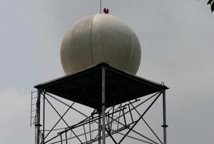 A doppler radar provides long-range weather detection and surveillance.