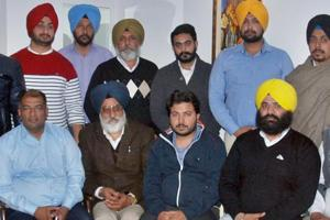 Durgesh Pathak (centre), AAP organisation-building head, with party colleagues in Amritsar on Tuesday.
