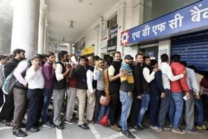 Rush at banks likely to last another week as people queue up to...