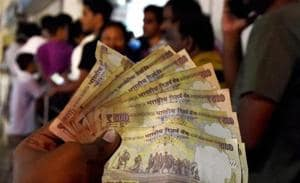 Banks may be flush with cash after demonetisation pushed people to deposit old Rs 500 and Rs 1,000 notes into bank accounts, but it has also compounded problems. Banks, already operating on wafer-thin margins, are expected to take a hit on their earnings due to low demand, delaying their ability to pass on the rate cuts widely expected in RBI's monetary policy on Wednesday.