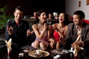 Men link eating more in social settings with strength, virility