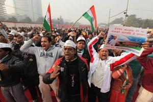 Supporters of Anna Hazare raise slogans during their agitation for Jan Lokpal bill at Ramlila Ground in New Delhi,  in 2011. There are several ambiguities in the Lokpal &Lokayuktas  Act, which in current form, strongly discourage participation of citizens in social and humanitarian activities.
