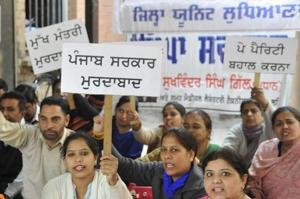 Members of Medical Laboratory Technician Association protestingt at Civil Surgeon office in Ludhiana on Tuesday.