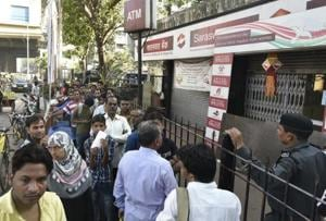 Demonetisation blues: Month later, gruelling wait in long queues...