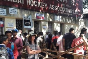 Fans queue up outside the Wankhede Stadium premises to pick up their tickets for the India vs England Test match that started in Mumbai on Thursday.
