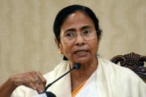 Govt is acting like a salesman trying to sell plastic cards: Mamata...