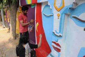 Gurgaon: Artists use Bhagavad Gita to give neglected wall a new life
