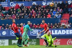 Lionel Messi, Luis Suarez finish off Osasuna to get Barcelona back on...