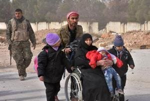 Thousands flee Syria's Aleppo as Assad nears victory
