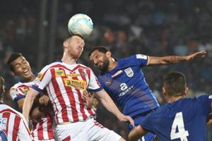 Atletico de Kolkata and Mumbai city FC players vie for the ball during ISL Semi Final match in Mumbai.