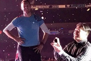 Chris Martin spreads love, stops his show for a fan proposal