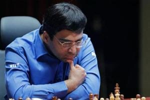 The draw against Michael Adams has kept Viswanathan Anand in contention for the London Chess Classic title.