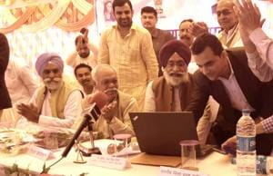 Shrikaranpur MLAand mines minister Surendra Pal Singh holds a meeting with elected representatives, businessmen and workers at Padampur village to convince them for a switch to cashless transactions.