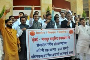Shiv Sena MLAs protest against the alleged land grab outside the Vidhan Bhavan in Nagpur on Friday.