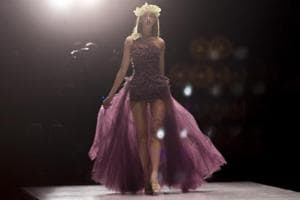 A model walks the ramp in a burgundy-coloured outfit. According to fashion designers, burgundy is the new hot favourite colour of the season.