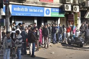The Reserve Bank of India's latest restriction on deposits over Rs 5,000 in old currency notes has saddled bankers with more work, apart from also having to face irate customers asking them for explanations as to why they couldn't come earlier.