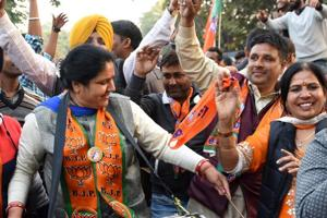 BJP supporters celebrating the landslide victory in MC elections outside the party office in Chandigarh on Tuesday.