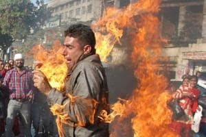 A protester accidentally caught fire when he jumped over a burning effigy of Punjab government at Fauji Chowk in Bathinda on Wednesday.