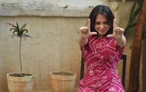 Annie Zaidi poses at her Mira Road residence