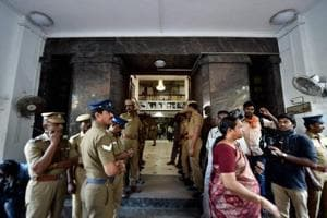 Policemen stand at the main entrance of Tamil Nadu state secretariat during an income tax raid at the chamber of chief secretary P Ramamohana Rao.