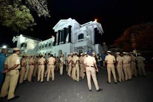 """Chennai: Police Personnel stands at Tamil Nadu State """"Secretariat"""" during the raid at the chamber of Chief Secretary P Ramamohana Rao, who came under the I-T scanner in Chennai on Wednesday."""