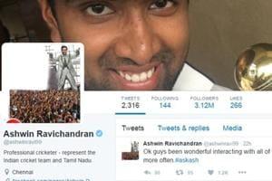 Ravichandran Ashwin head-and-shoulder with superhero Rajinikanth after...