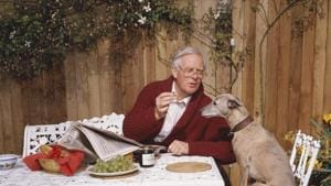 John L Carre offering his whippet a grape, circa 1990.