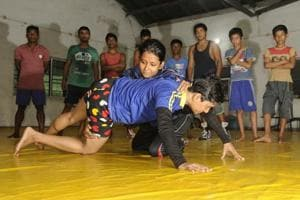 Women wrestlers practising at Panchanan Bayam Samiti, one of the few wrestling clubs for women in Bengal.