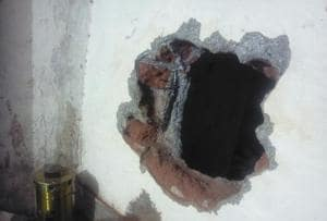 The hole that the thieves dug to steal the jewellery.