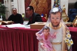 A religious figurine is seen at a check-in desk for the ninth Chinese Catholic representative conference in Beijing.