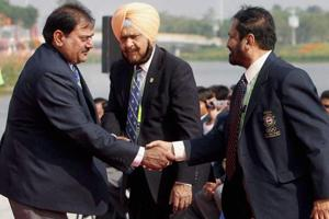 Former Indian Olympic Association president Suresh Kalmadi shakes hands with India