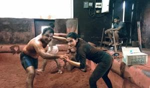 Kripa Shankar Bishnoi training actress Fatima Khan during Dangal shooting.