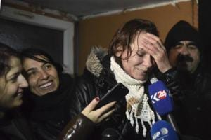 Turkish novelist Asli Erdogan, who was arrested in August, speaks to the media after her release from Silivri prison outside Istanbul, late Thursday, Dec. 29, 2016. Erdogan is accused of membership in the outlawed Kurdistan Workers