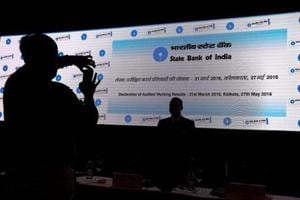 A screen displaying the State Bank of India (SBI) logo before the start of a news conference in Kolkata.